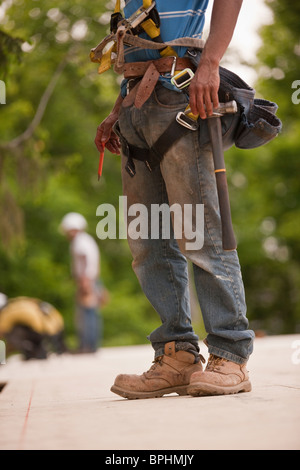 Carpenter working at a construction site - Stock Photo