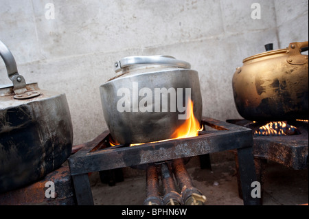 Old fashioned kettles on gas stove - Stock Photo