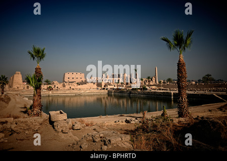 Karnak Temple Complex, The Sacred Lake of Precinct of Amun-Re, Luxor, Egypt, Thebes, Arabia, Africa - Stock Photo