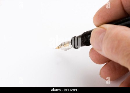 Fountain pen in mans hand. - Stock Photo