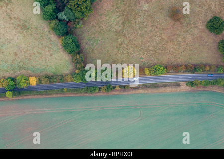 Aerial view of road cutting through countryside south of Norwich Norfolk - Stock Photo