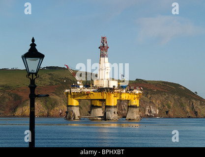 The semi-submersible Oil Drilling rig Transocean Rather moored in the Cromarty Firth, Scotland, framed by an street lamp