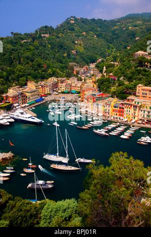 Boats moored in the tiny harbor of Portofino, Liguria Italy - Stock Photo