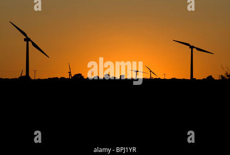 Cold Northcott wind farm, Cornwall. Turbines silhouetted against sunset. - Stock Photo