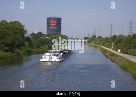 Oberhausen Gasometer with river Rhine-Herne-Canal and lighter, Oberhausen - Neue Mitte, Ruhrgebiet, North Rhine - Stock Photo