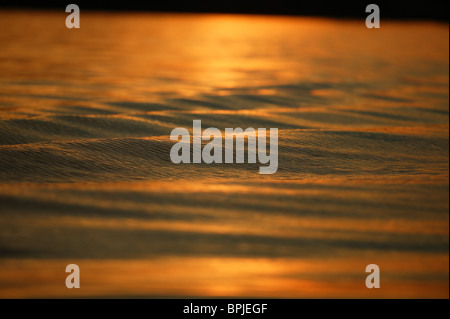 Water surface in the evening light, Lake Chiemsee, Chiemgau, Bavaria, Germany - Stock Photo