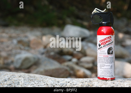 Counter Assault Bear Spray on rock in the White Mountains, New Hampshire USA - Stock Photo