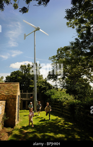 A wind turbine in the garden of a family home in Buckinghamshire UK - Stock Photo
