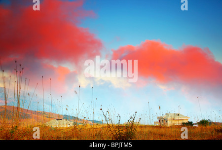 Dramatic sunset in the mountain village - Stock Photo