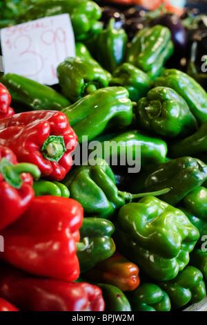 Shiny fresh produce stacked high in a market - Stock Photo