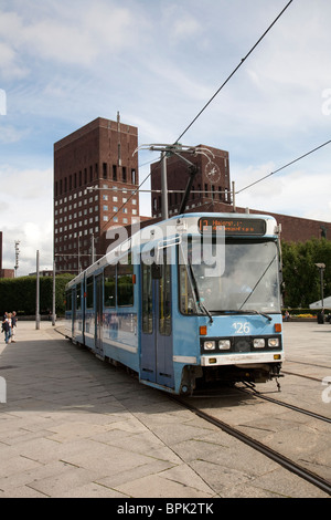 Picture shows a Tram in front of the Radhus Oslo Town Hall, Oslo Harbour, Oslo, Norway. Photo:Jeff Gilbert - Stock Photo