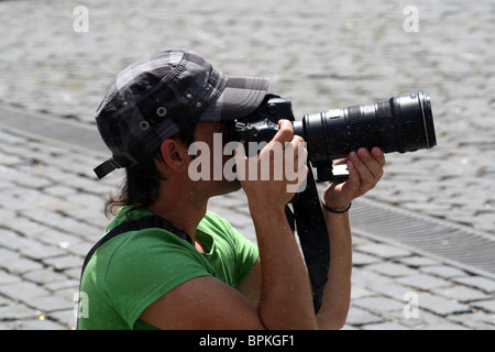 Reporting on the holidays of San Fermin, Pamplona, Navarre, Spain. - Stock Photo