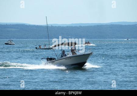 Recreational boaters enjoy Sunday afternoon on Lake Canandaigua, New York. - Stock Photo