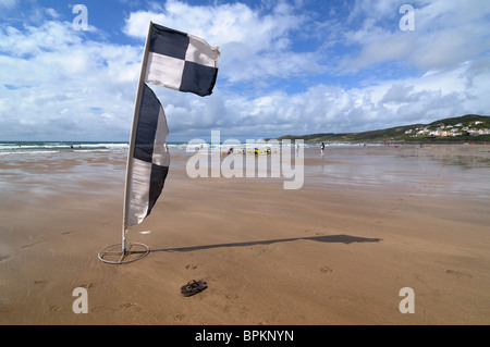 Lifeguard's safety flag on the beach at Woolacombe, Devon, UK - Stock Photo