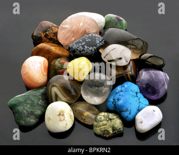 Gemstones - crystals on grey background - Stock Photo