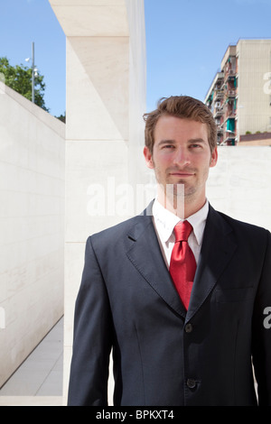 Businessman smiling and looking ahead - Stock Photo