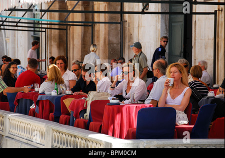 DUBROVNIK, CROATIA. Customers drinking on the outdoor terrace of Gradskavana cafe on Luza Square in Dubrovnik old - Stock Photo