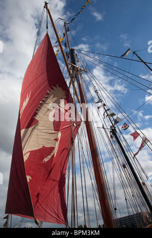 The red sail of a ship. Amsterdam Sail 2010 - Stock Photo