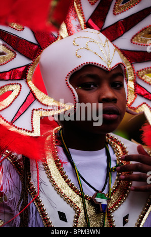 Portrait of a boy at the Notting Hill Carnival Children's Day Parade, London, England, UK - Stock Photo