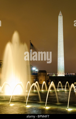 WASHINGTON DC, USA - Night shot of the fountains of the National World War II Memorial with the Washington Monument - Stock Photo