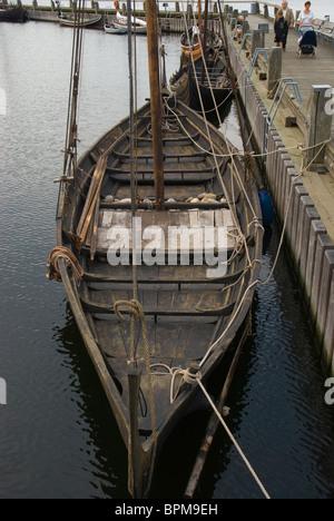 Viking ear replica boats at the harbour of Roskilde Fjord lake Roskilde Denmark Europe - Stock Photo
