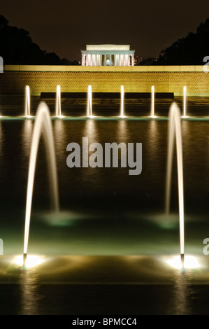 WASHINGTON DC, USA - Night shot of the fountains of the National World War II Memorial with the Lincoln Memorial - Stock Photo
