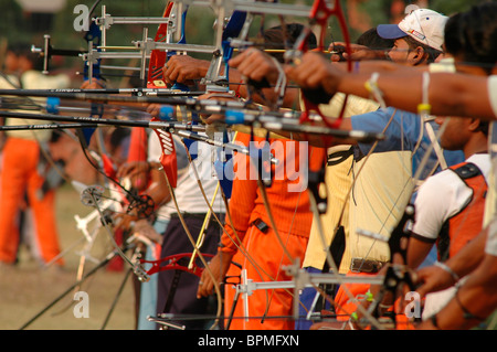 Young Indian archers at an archery contest. - Stock Photo
