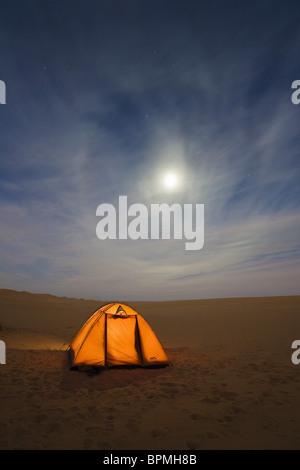 camping under the starry sky in the libyan desert, Moon Halo, Libya, Sahara, Africa - Stock Photo