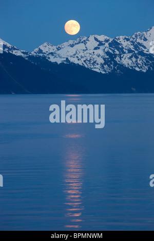 Full moon over Resurrection Bay, Seward, Alaska. - Stock Photo