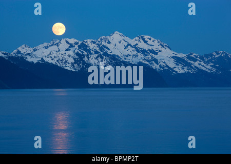 Full moon over Resurrection Bay, Seward, Alaska. - Stock Photo