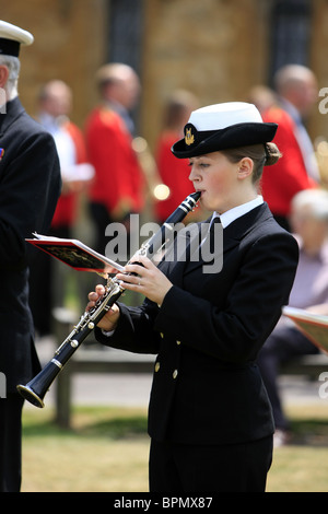 Royal Navy Bandswoman playing a clarinet from HMS Heron in Sherborne Dorset on the UK Armed Forces Day Parade June - Stock Photo