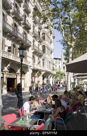 Street cafe at Passeig de Gracia, Barcelona, Catalonia, Spain - Stock Photo