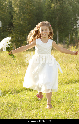 Little girl with flowers - Stock Photo