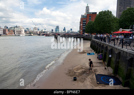 sand sculpture on river Thames beach near Gabriel's Wharf, Southbank, London, England, UK. - Stock Photo