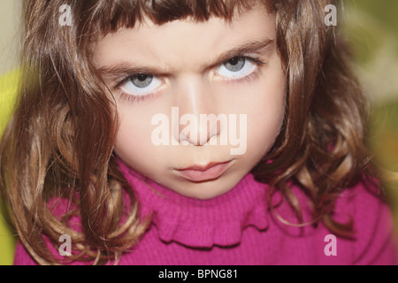 defy outface little girl portrait looking camera gesture blue eyes - Stock Photo