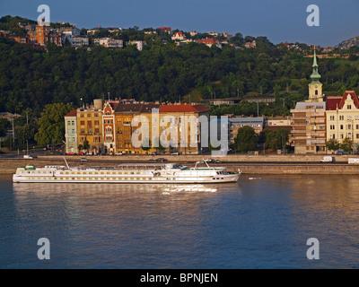 Danube River, River cruise ship and Buda. Budapest, Hungary - Stock Photo