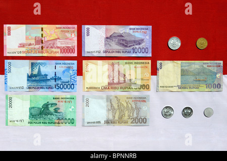 indonesian rupiah notes and coins reverse side in current use as of august 2010 - Stock Photo