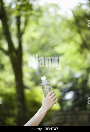 Closeup of hand holding plastic bottle - Stock Photo
