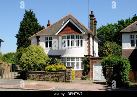 1930's Detached House with garage London England UK - Stock Photo