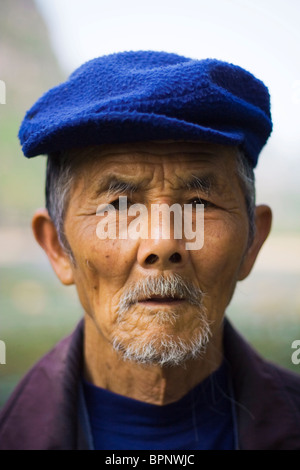 Portrait of old man in Yangshuo, Guangxi Province, China. Asia - Stock Photo