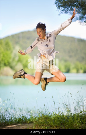 Woman jumping in the air - Stock Photo
