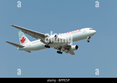 An Air Canada Boeing 767-333/ER makes an approach on final for landing at Lester B. Pearson International Airport. - Stock Photo
