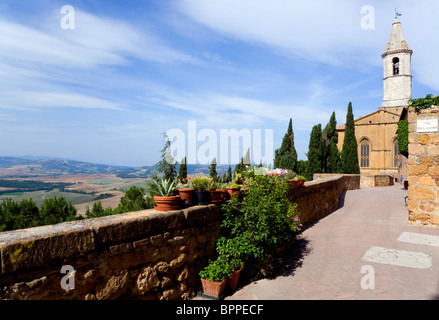 ITALY Tuscany Pienza Val D'Orcia The bell tower of the Duomo on Via Dell' Amore with cypress trees overlooking countryside - Stock Photo