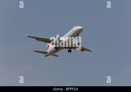 Air Canada Embraer 170-200LR on final approach to landing. - Stock Photo
