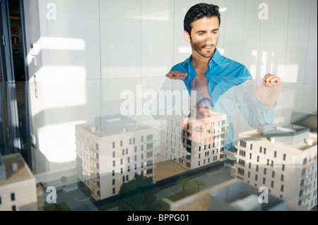 Man looking at architectural model - Stock Photo