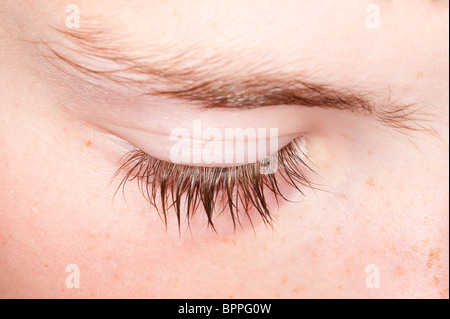 A close up of ten year old boys eyelash in the Uk - Stock Photo