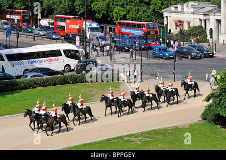 Aerial view from above looking down on Hyde Park Corner road junction horses & soldiers Household Cavalry on way - Stock Photo