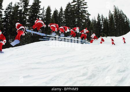 Santa claus snowboarding sequence - Stock Photo