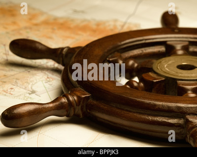 helm and the map,shallow DOF, useful for various navigation or travel themes - Stock Photo