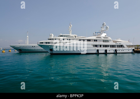 Superyachts 'Battered Bull' and 'Ecstasea' moored at the marina in Antibes, France - Stock Photo